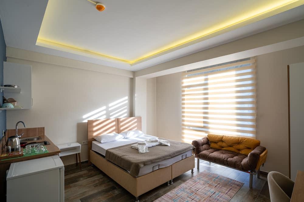Habitación Deluxe, cocina básica - Sala de estar