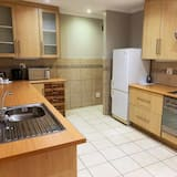 Izba typu Deluxe - Spoločná kuchyňa