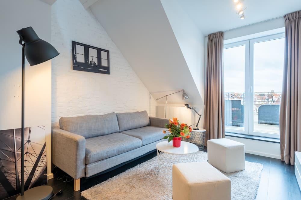 Panorama-lejlighed - 1 soveværelse - Opholdsområde