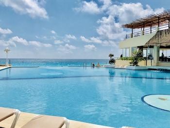 在Avenida Kukulkan (库库尔坎大道)的海滩和海滨公寓酒店 1照片