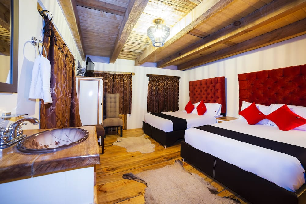 غرفة ديلوكس - سريران كبيران - منظر للحديقة - الصورة الأساسية