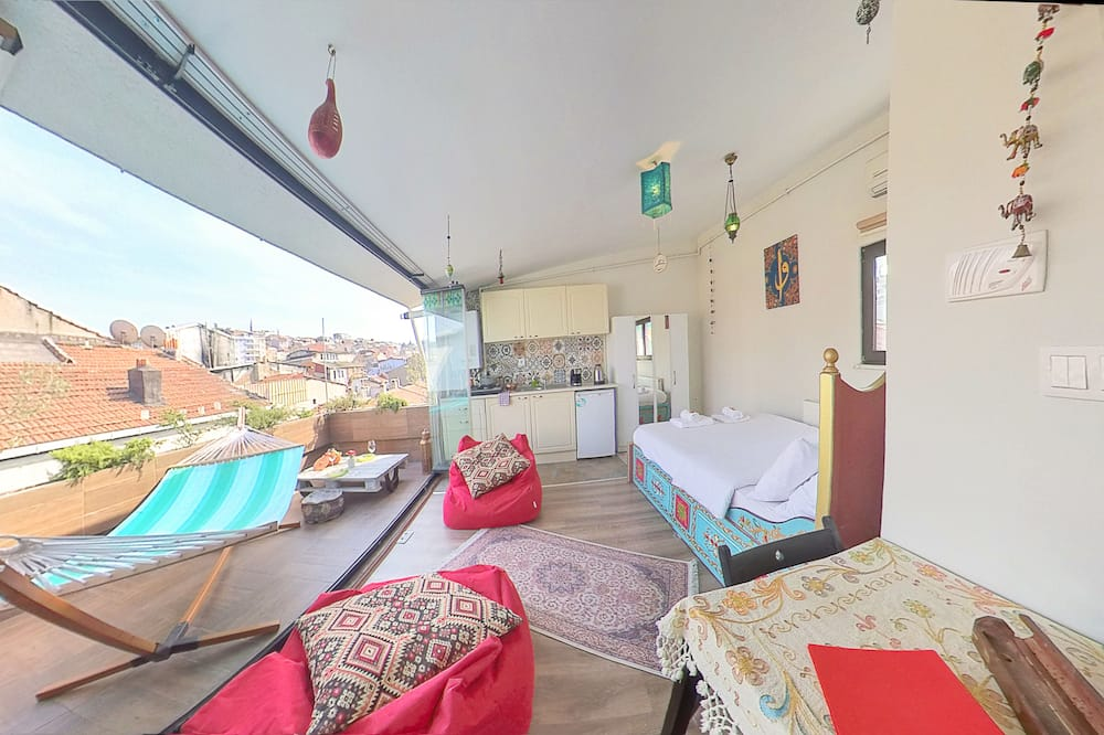 Loft Romântico, 1 cama de casal, Terraço, Vista Cidade - Área de Estar