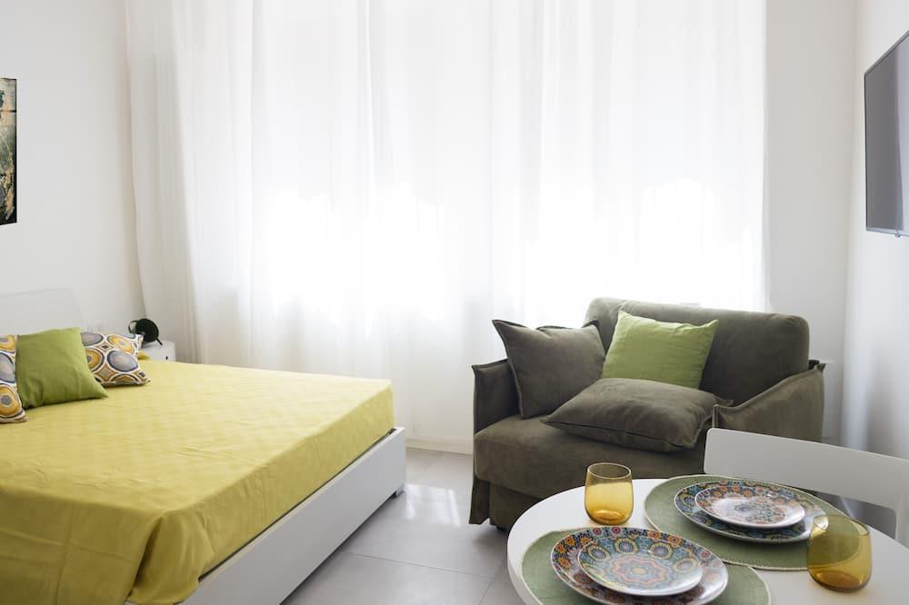 Monolocale (verde) - Area soggiorno