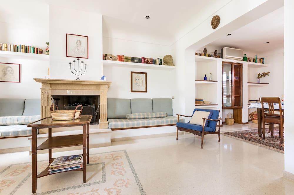 Standardní domek, 3 ložnice - Obývací pokoj
