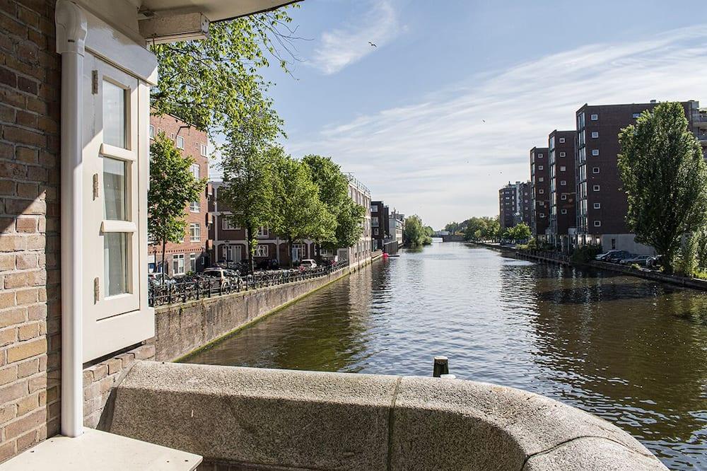 Apartamentai - Vaizdas į vandens telkinį