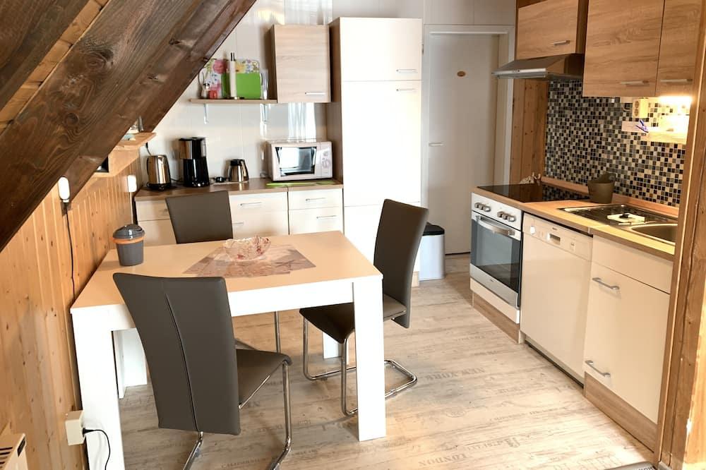 Ferienwohnung, 1 Schlafzimmer, Nichtraucher, Balkon (Cleaning fee 60,00 EUR) - Essbereich im Zimmer