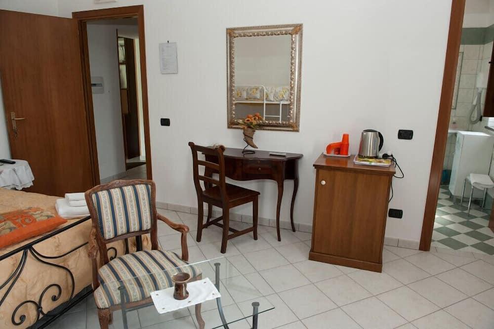 Třílůžkový pokoj typu Superior - Obývací prostor