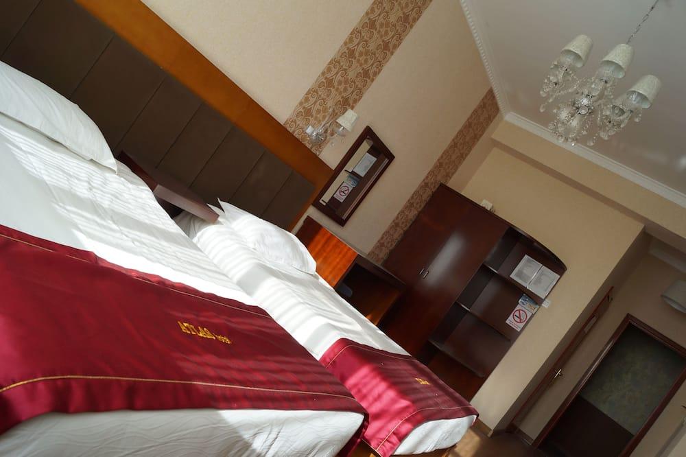 Habitación básica con 1 cama doble o 2 individuales - Camas extra