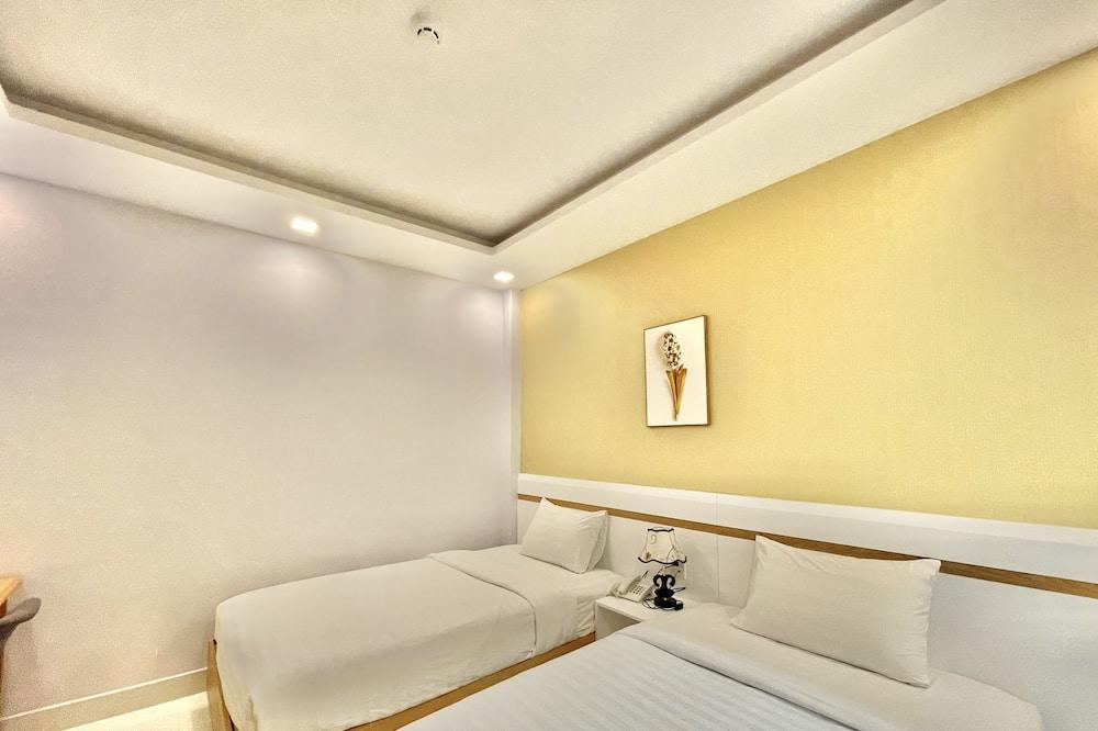 Chambre Standard avec lits jumeaux, pas de fenêtre - Coin séjour