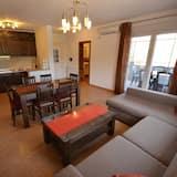 Апартаменты, 2 спальни (A1) - Зона гостиной