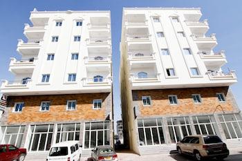 Фото OYO 128 Al Tawasi Furnished Apartments у місті Салала