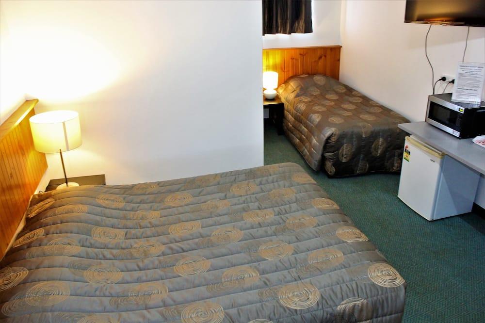 Dvivietis kambarys (2 viengulės lovos) su patogumais - Svetainės zona