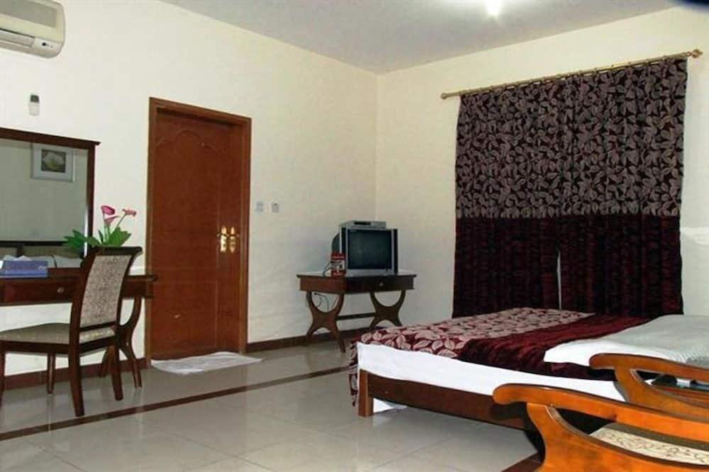 Standardní jednolůžkový pokoj - Obývací prostor