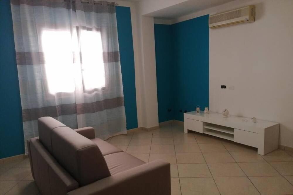 Семейные апартаменты, 1 двуспальная кровать с диваном-кроватью - Зона гостиной