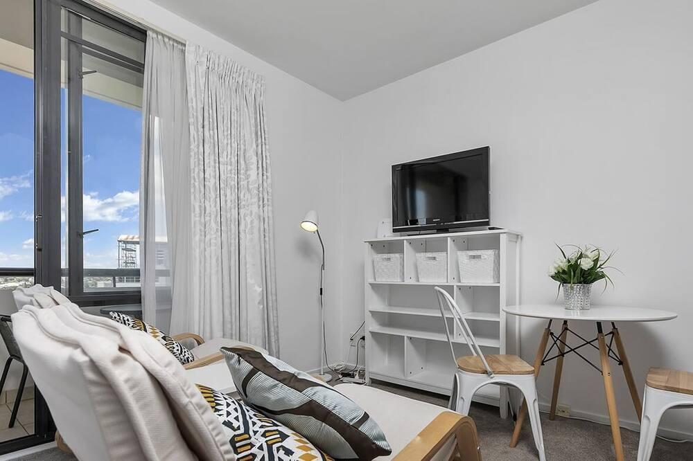 Studio, 1 queensize bed, Uitzicht op de stad - Woonkamer