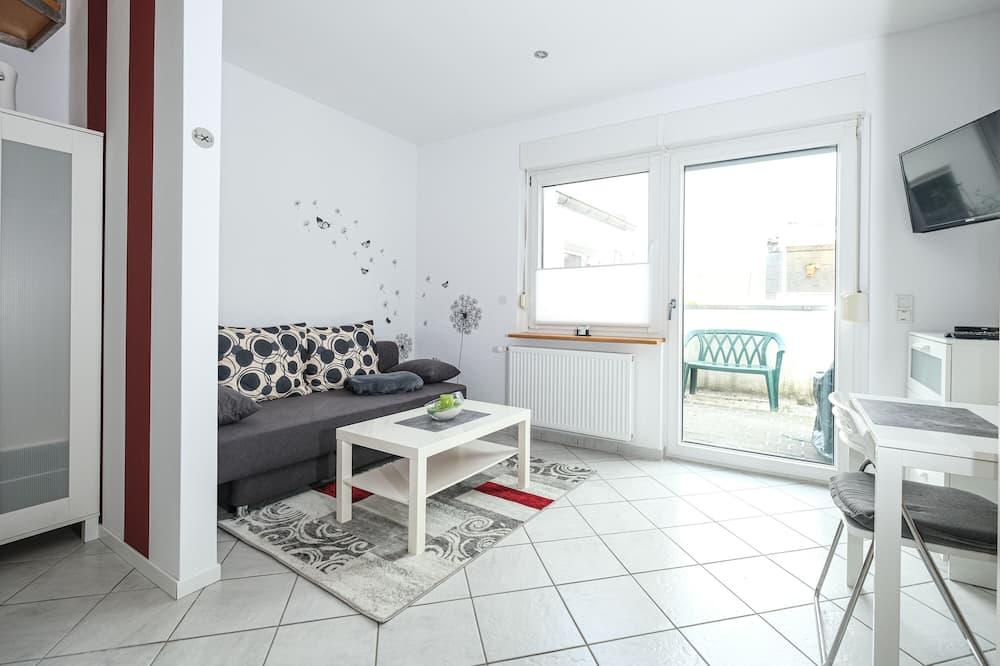 クラシック アパートメント クイーンベッド 1 台ソファーベッド付き - リビング エリア
