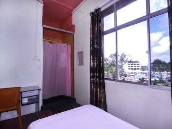Φωτογραφία του SPOT ON 89823 Rooms Inn, Κουτσίνγκ