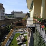 Deluxe kamer, 1 twee- of 2 eenpersoonsbedden, uitzicht op tuin - Uitzicht vanaf balkon