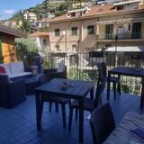 Deluxe kamer, 1 twee- of 2 eenpersoonsbedden, uitzicht op tuin - Balkon