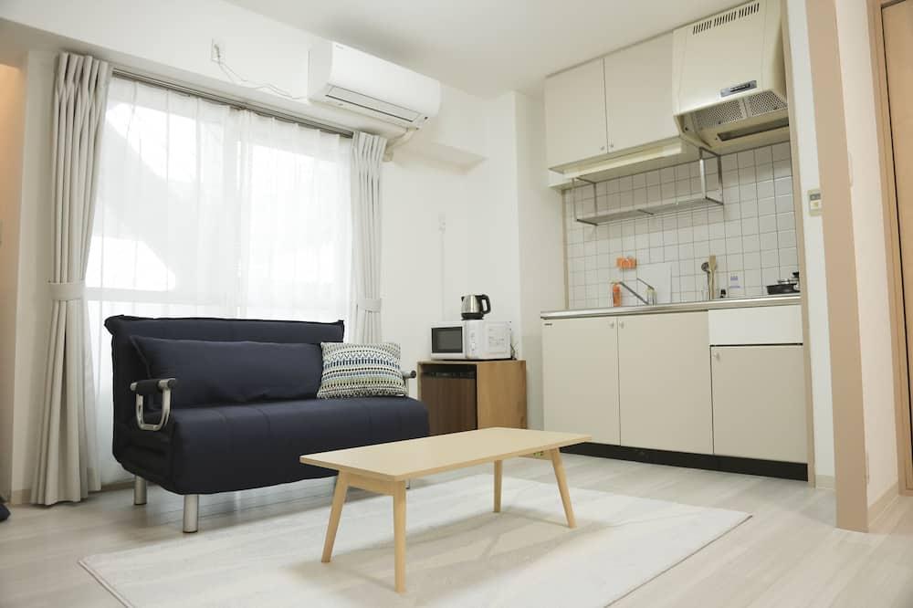 Apartmán typu Superior, kuchyňa, výhľad na mesto - Obývacie priestory