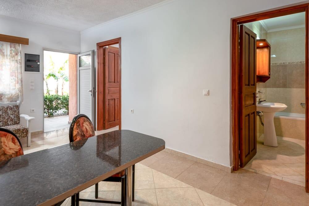 Comfort-Apartment, 1 Schlafzimmer, Poolblick - Wohnzimmer