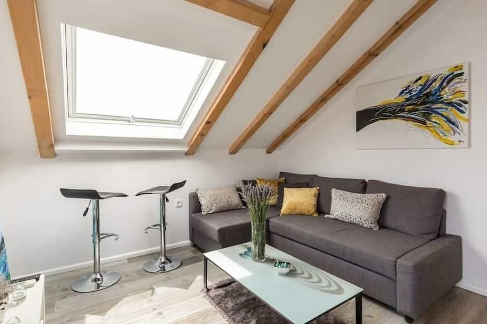 Dzīvokļnumurs, skats uz jūru - Dzīvojamā istaba
