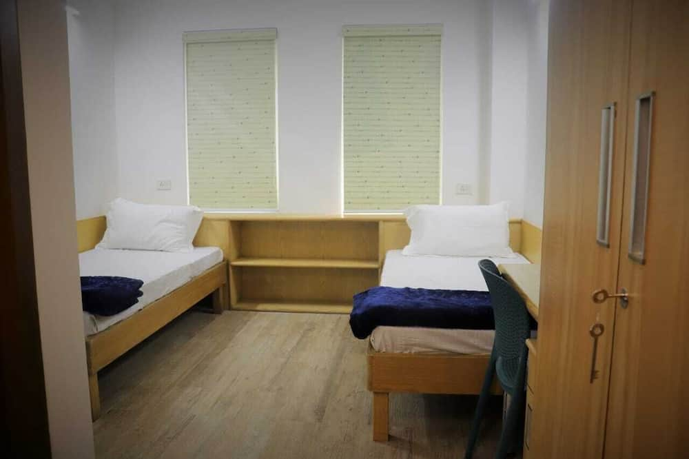 Prabangaus stiliaus kambarys (1 dvigulė / 2 viengulės lovos) - Svečių kambarys