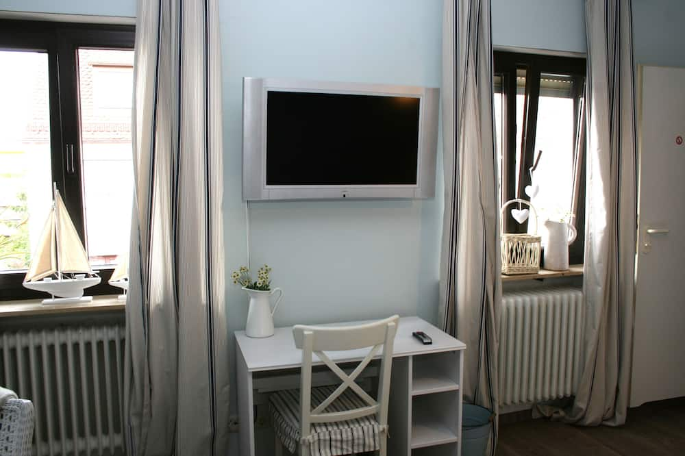 غرفة مزدوجة بتصميم مميز - منطقة المعيشة