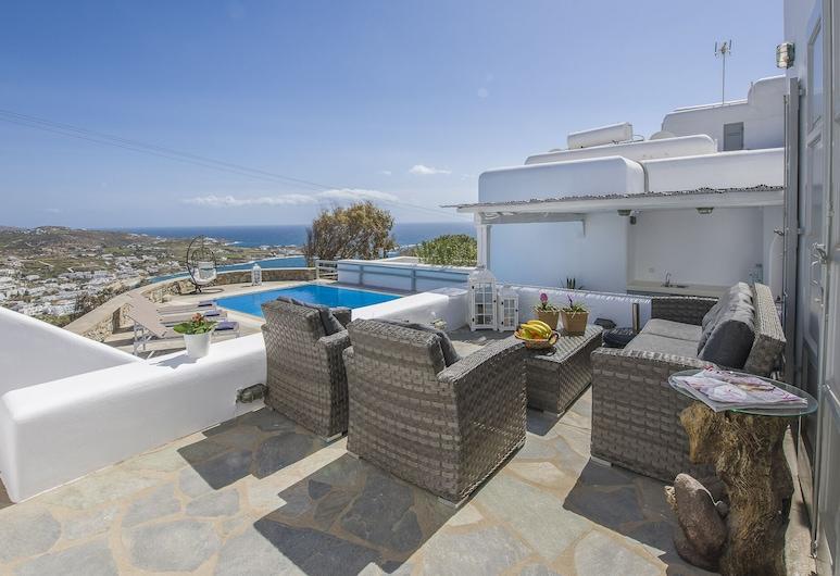 Mykonos Psarrou villa for 18 persons by VillaRentalsgr, Míkonos, Villa panorámica, varias habitaciones, piscina privada, vistas al mar, Terraza o patio