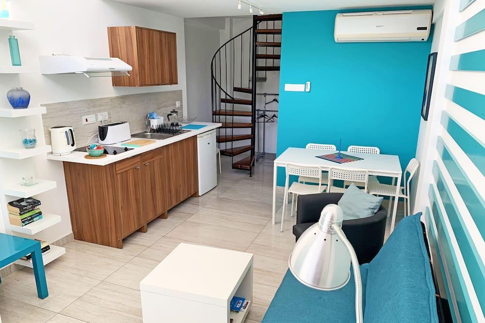 อพาร์ทเมนท์สำหรับครอบครัว (Blue Maisonette) - ห้องนั่งเล่น