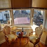 Deluxe dubbelrum - utsikt mot staden - Vardagsrum
