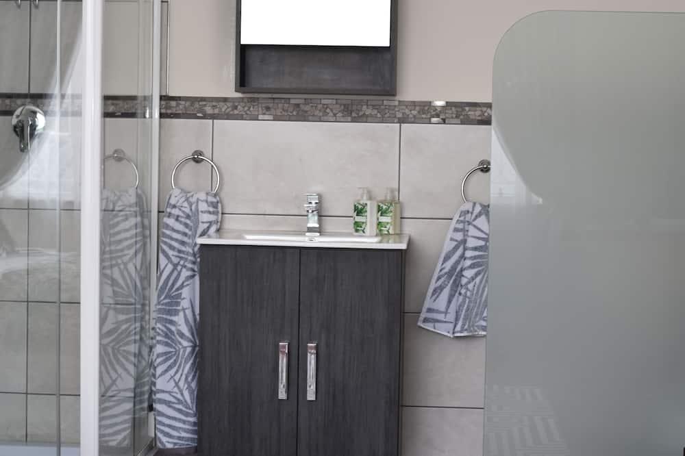 Izba typu Deluxe (Pollination) - Umývadlo v kúpeľni