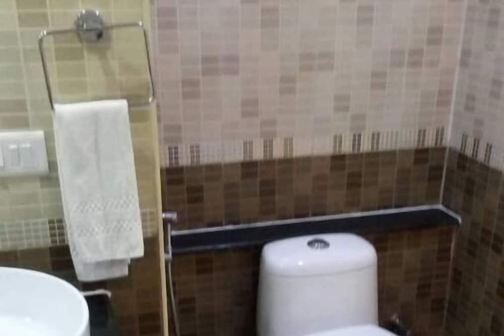 Izba typu Deluxe s dvojlôžkom alebo oddelenými lôžkami - Kúpeľňa