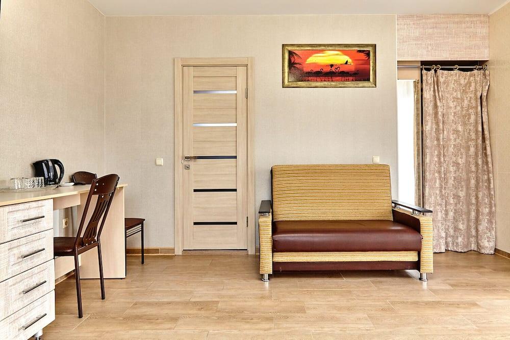 Comfort Quadruple Room, Balcony - Living Area