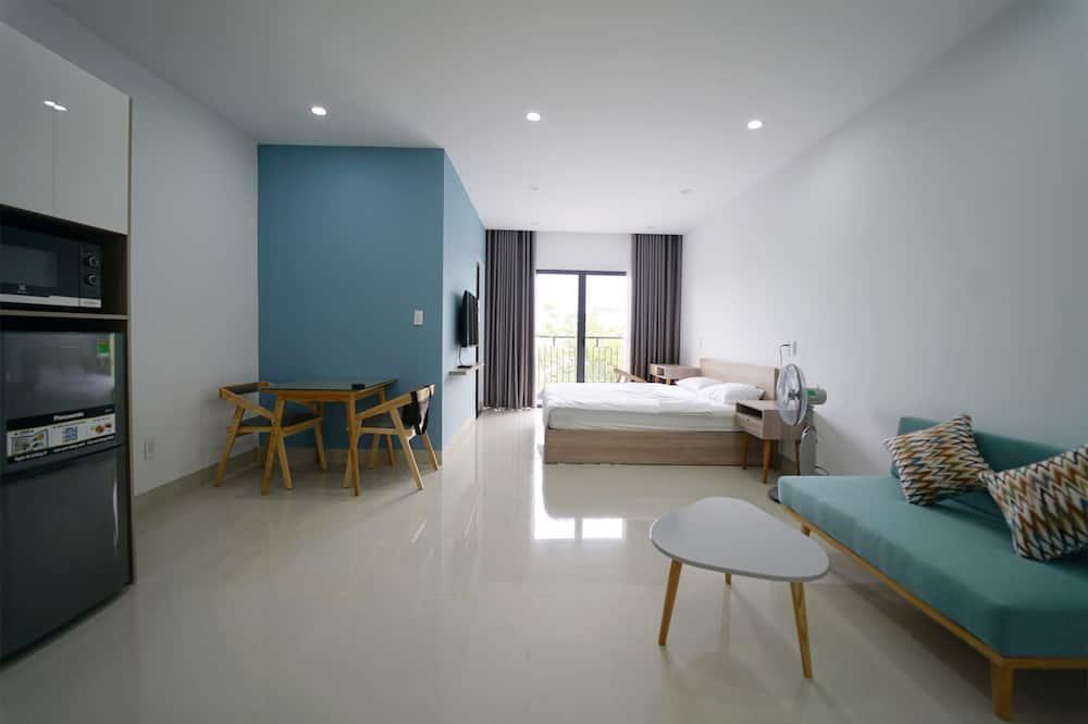 สแตนดาร์ดสตูดิโอ, เตียงคิงไซส์ 1 เตียง, ระเบียง, วิวเมือง (Bright) - พื้นที่นั่งเล่น