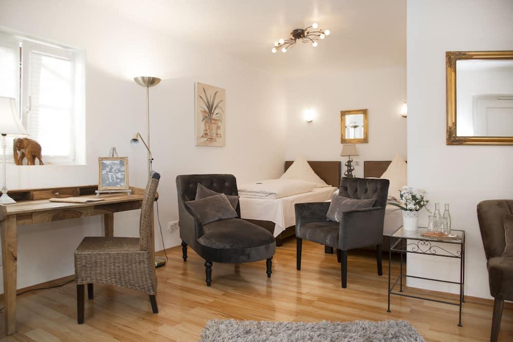 Chambre Double Confort - Coin séjour