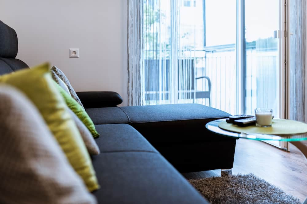 Appartement Deluxe, 2 chambres, non-fumeurs, terrasse - Coin séjour