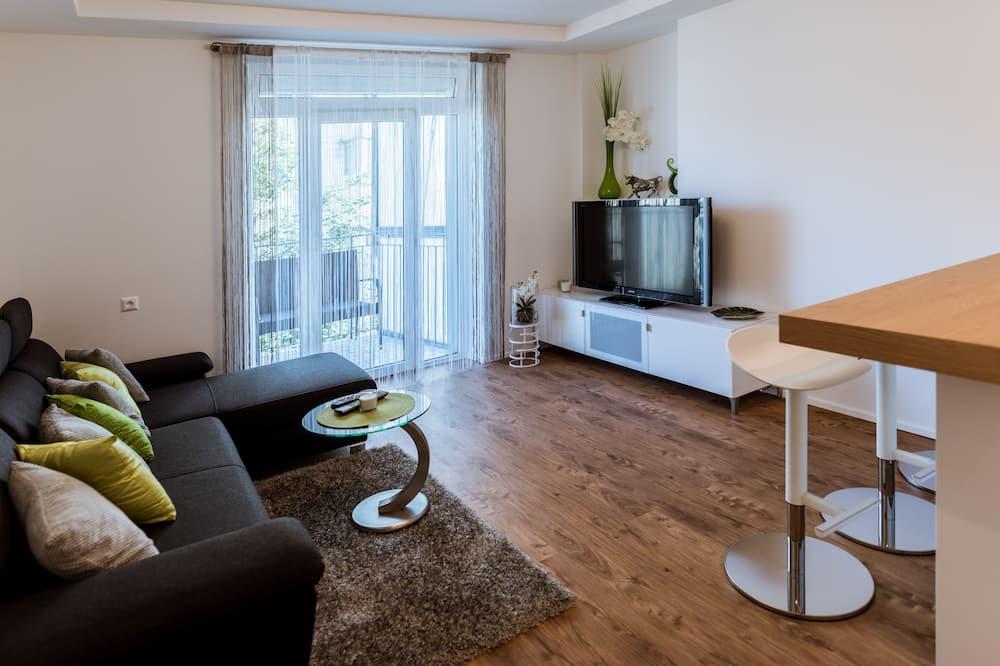 Appartement Deluxe, 2 chambres, non-fumeurs, terrasse - Salle de séjour