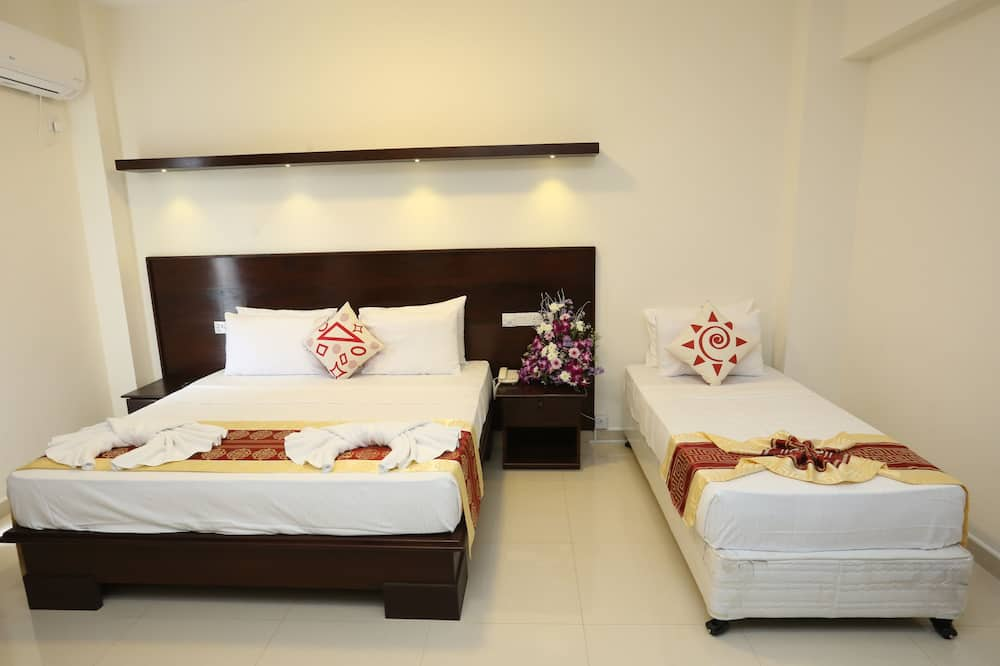 Deluxe Triple Room, 1 King Bed, City View - Guest Room