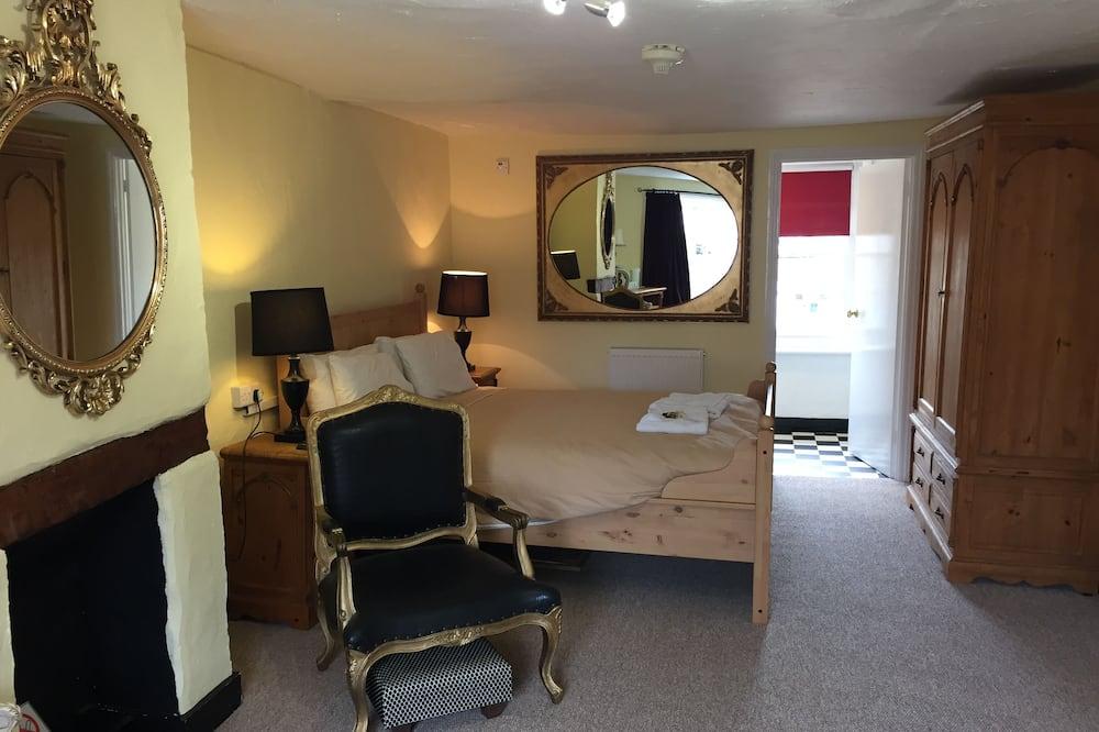 Chambre Familiale, salle de bains attenante - Coin séjour