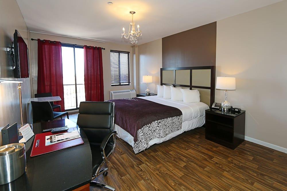 ห้องเอ็กเซกคิวทีฟ, เตียงคิงไซส์ 1 เตียง, ห้องครัวขนาดเล็ก - พื้นที่นั่งเล่น