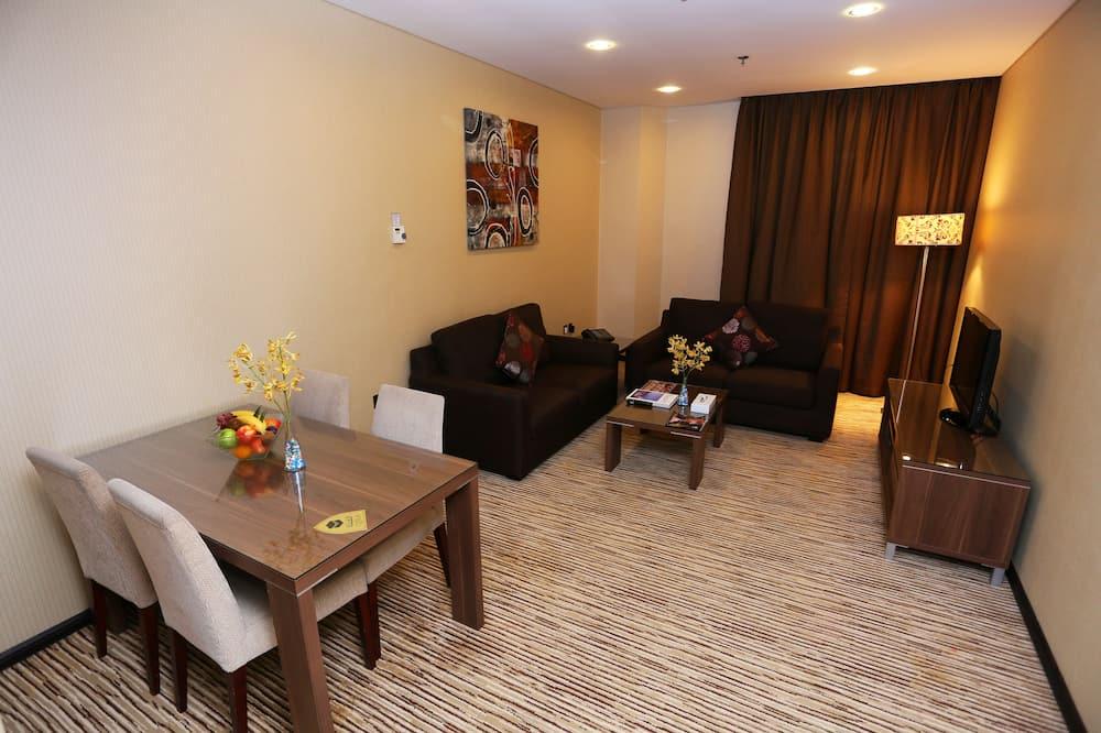 Deluxe Suite, Garden View - Living Room