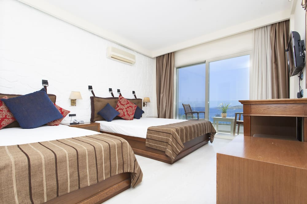 חדר דה-לוקס, מרפסת, נוף לים - תמונה