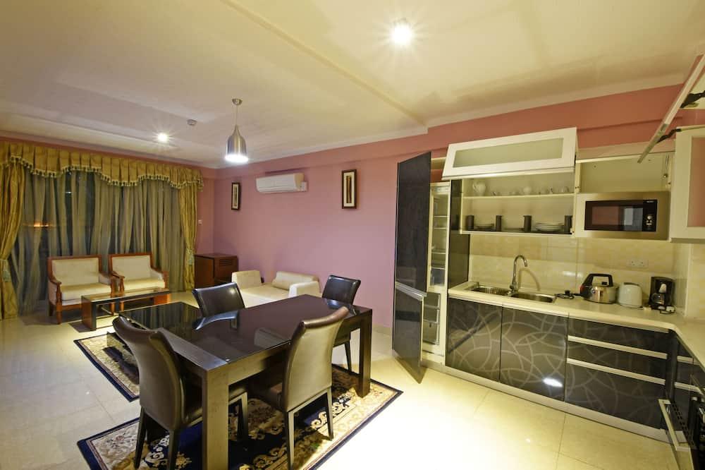 Executive suite, uitzicht op tuin - Woonkamer