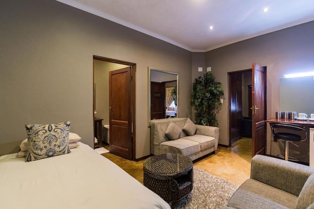 Люкс, 1 двуспальная кровать «Квин-сайз», вид на внутренний двор - Зона гостиной