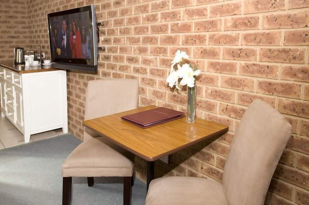 Executive-Zweibettzimmer - Essbereich im Zimmer