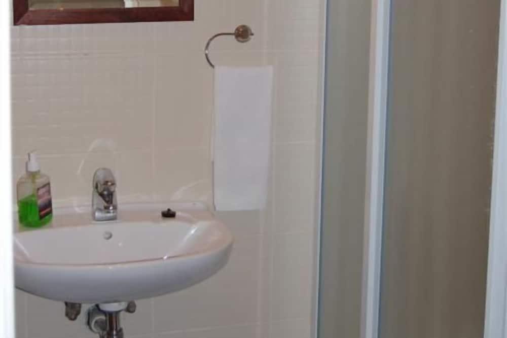 Yhden hengen huone, Makuuhuoneen yhteydessä oleva kylpyhuone - Kylpyhuone