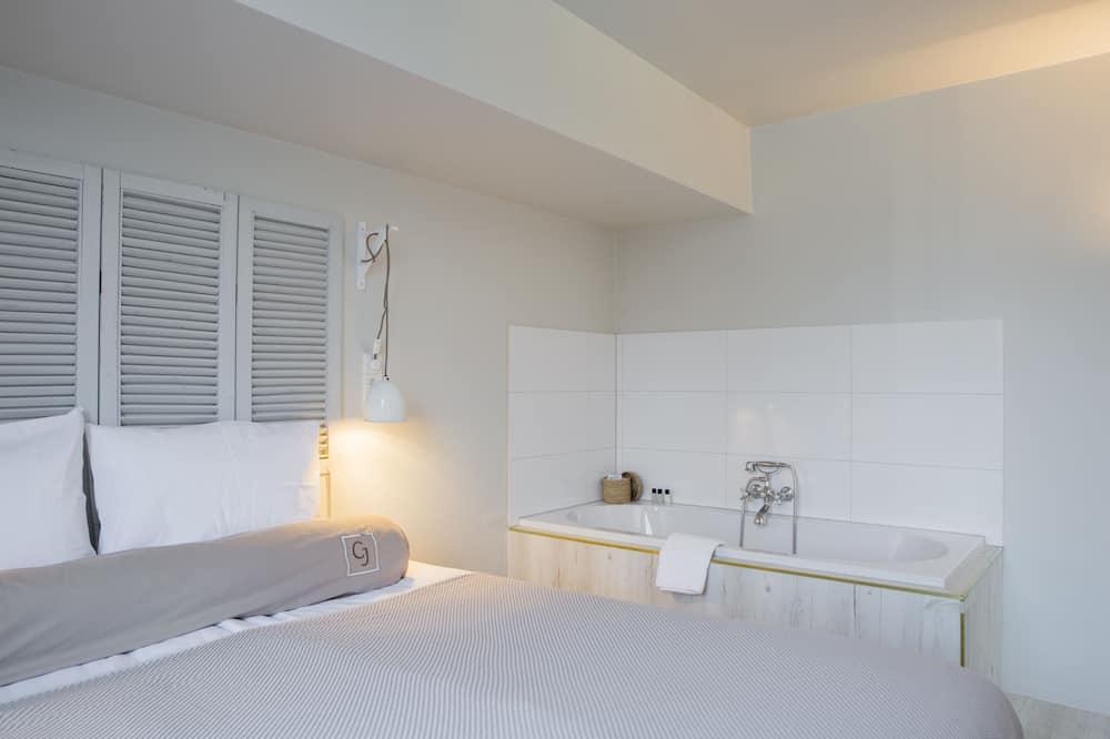 Junior suite, 1 tweepersoonsbed met slaapbank - Badkamer