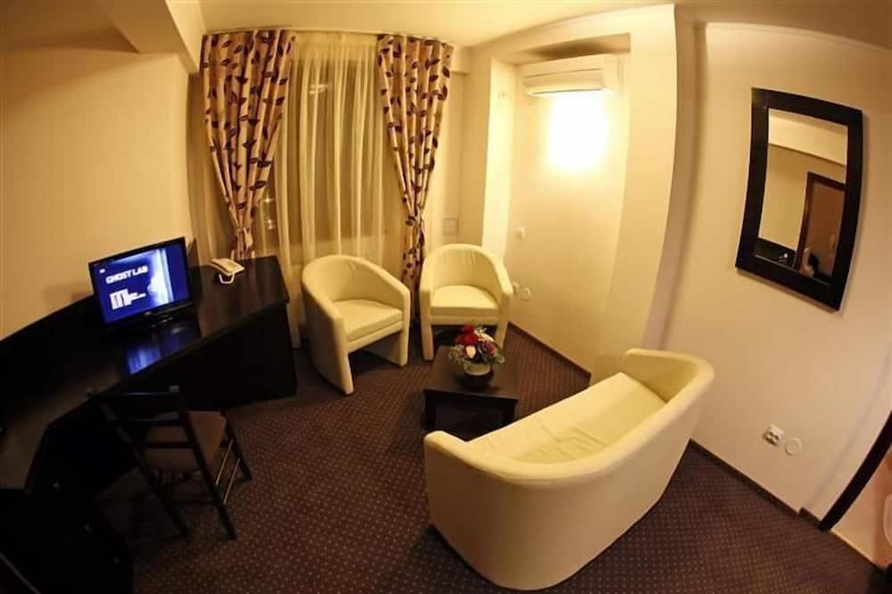 Suite Júnior (Single use) - Área de Estar