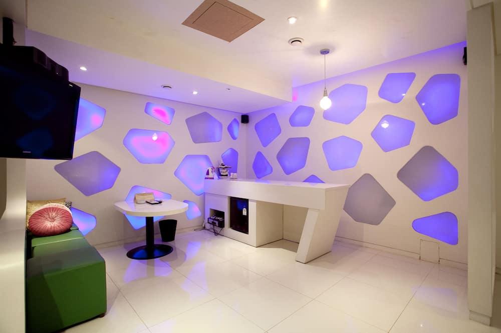 Chambre Double Deluxe - Salle de séjour